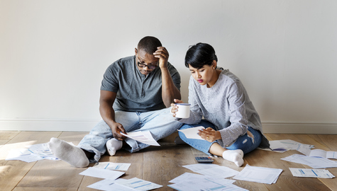 Couple reviewing bills and debt.
